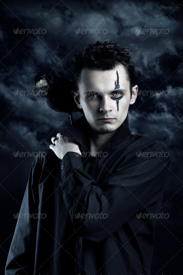 Spooky man with crow - Stock Photo - Images