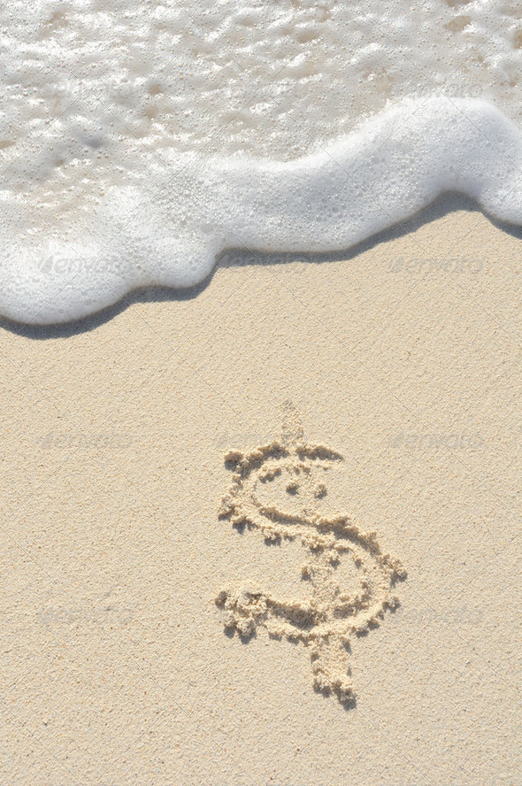 Dollar Sign Drawn in Sand on Beach - Stock Photo - Images