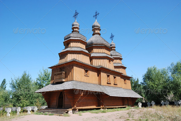 Wooden Orthodox church with ancient cemetery. - Stock Photo - Images