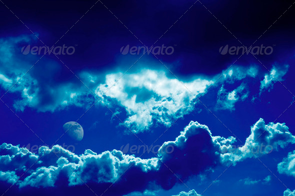 Dramatic dark blue clouds and moon background - Stock Photo - Images