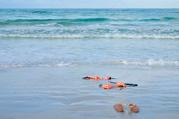 Skinny Dipping Orange Bikini on Beach - Stock Photo - Images