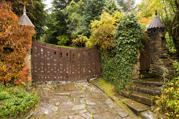 Wooden gate to house in autumn - Stock Photo - Images