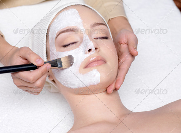 Woman having a facial cosmetic mask - Stock Photo - Images