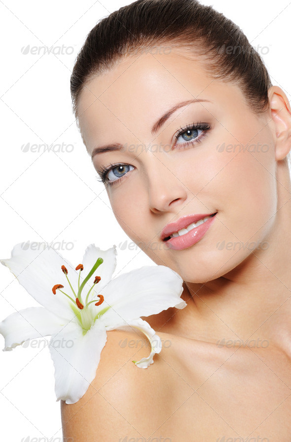 Face of health woman with lily close her face - Stock Photo - Images