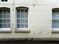 Urban white brick wall with windows - PhotoDune Item for Sale