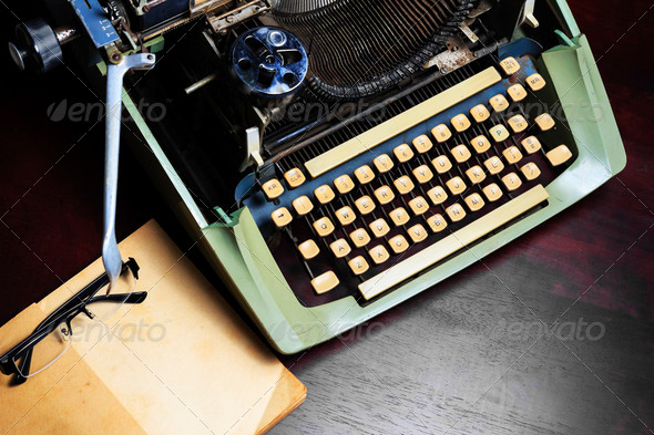 Old typewriter and old book on the table. - Stock Photo - Images