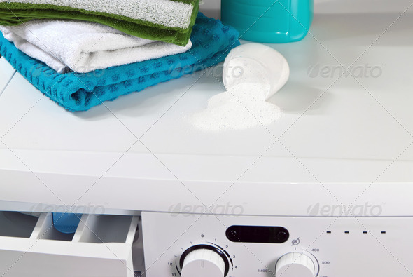 Washing machine and laundry powder for washing. - Stock Photo - Images