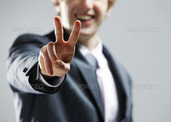 young businessman hand showing the victory sign. - Stock Photo - Images