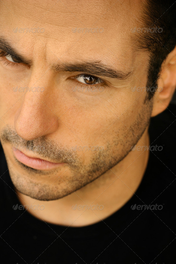 Extreme closeup portrait of a good looking man - Stock Photo - Images