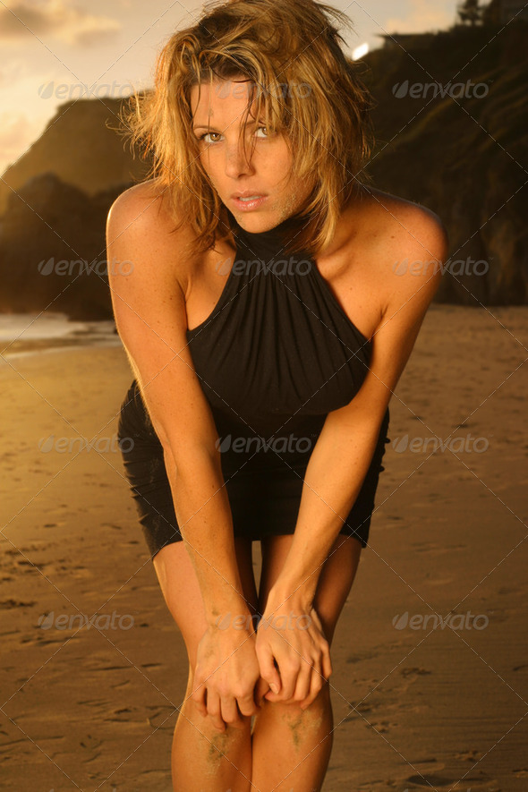 Sexy beach fashion portrait of beautiful woman in black dress - Stock Photo - Images