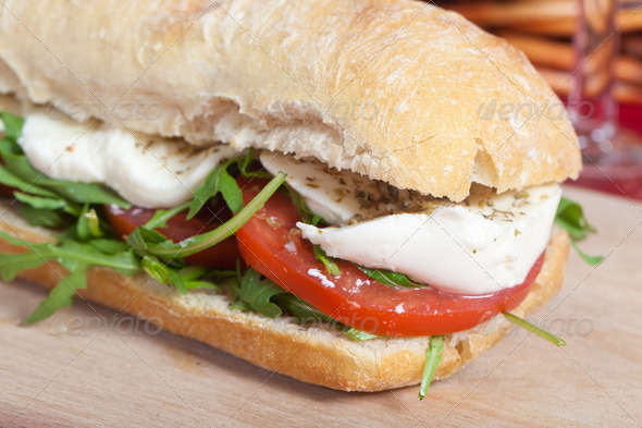 Sandwich with arugula, tomatoes and mozzarella - Stock Photo - Images