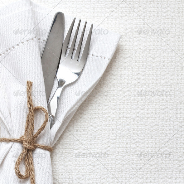 Knife and fork with white linen - Stock Photo - Images