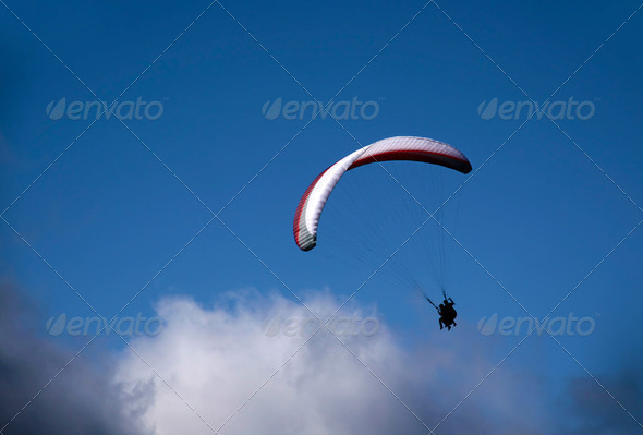 Paraglider in the clouds - Stock Photo - Images
