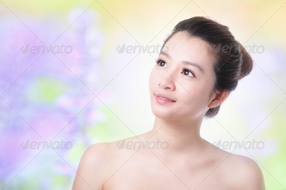 Skincare girl smile face look up forward - Stock Photo - Images