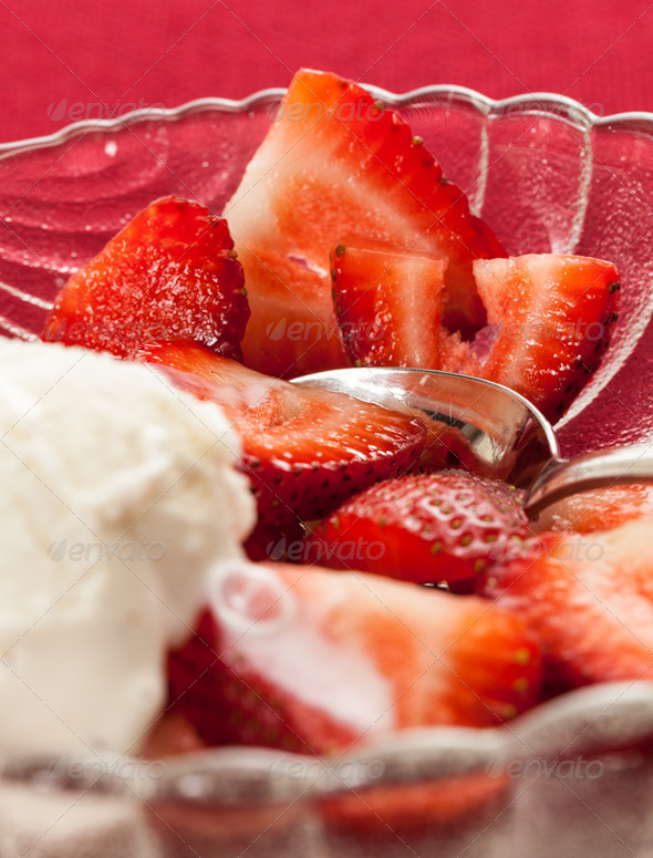 Fresh sliced strawberries in glass dish - Stock Photo - Images
