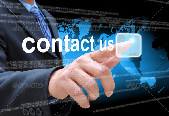 businessman hand pushing contact us button on a touch screen interface  - Stock Photo - Images