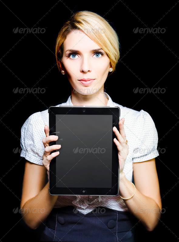 Business woman holding touchpad tablet - Stock Photo - Images