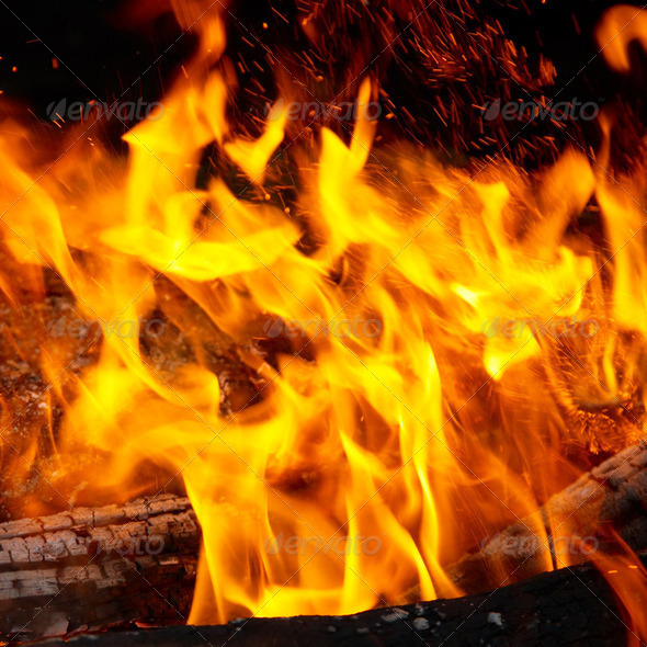 Flame tips on the firewood. - Stock Photo - Images