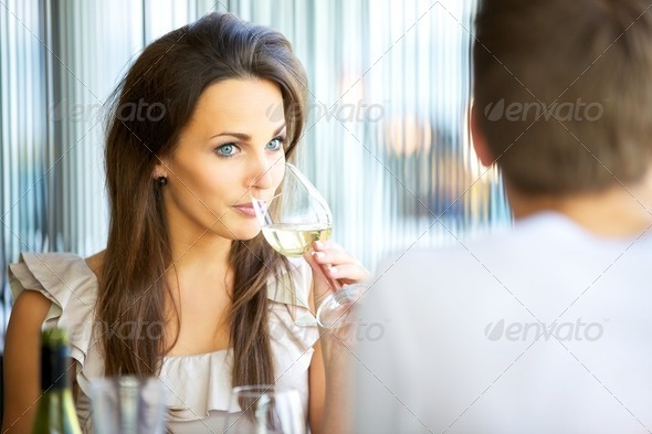 Attractive Woman Sipping Wine - Stock Photo - Images