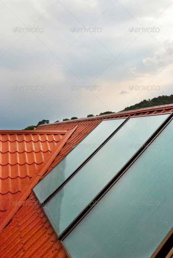 Solar panel (geliosystem) on the house roof. - Stock Photo - Images