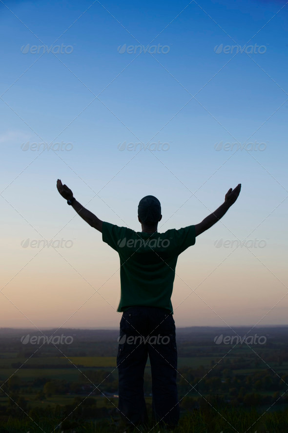 Man standing with arms outstretched - Stock Photo - Images