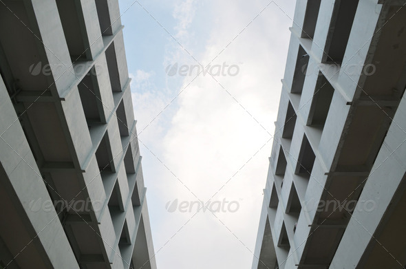 Low-angle view of a tall commercial building - Stock Photo - Images