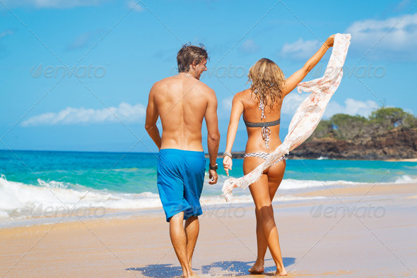Couple on the Beach - Stock Photo - Images