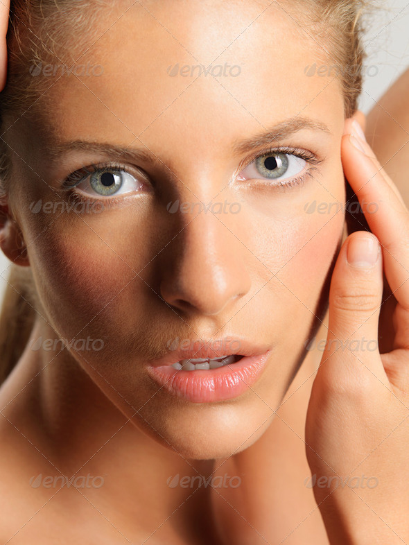 beauty portrait young woman touching her face - Stock Photo - Images