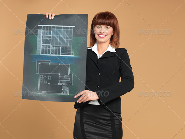 attractive, young architect showing blueprint of house - Stock Photo - Images