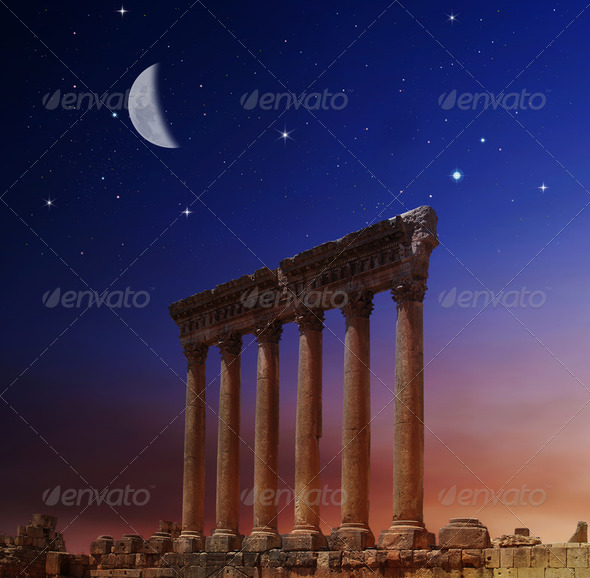 Jupiter's temple ancient Roman columns over sunset, Baalbek, Lebanon - Stock Photo - Images