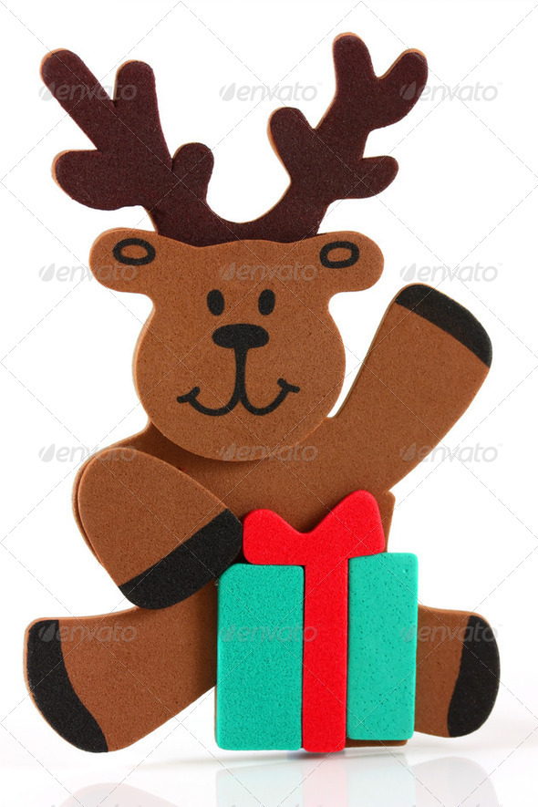 Reindeer sitting with a present - Stock Photo - Images