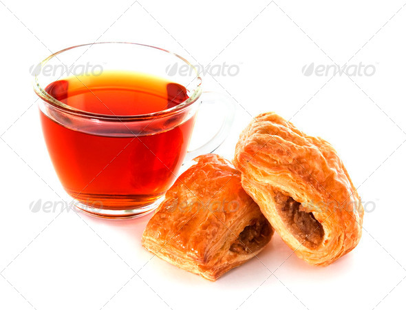 Cup of tea with cinnamon Danish bun - Stock Photo - Images