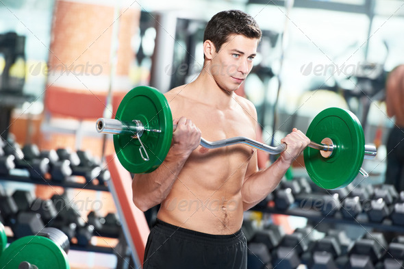 bodybuilder man doing biceps muscle exercises - Stock Photo - Images
