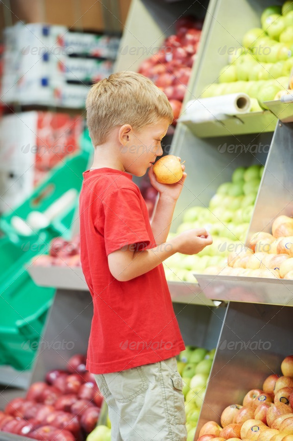 child boy making fruits vegetable shopping - Stock Photo - Images