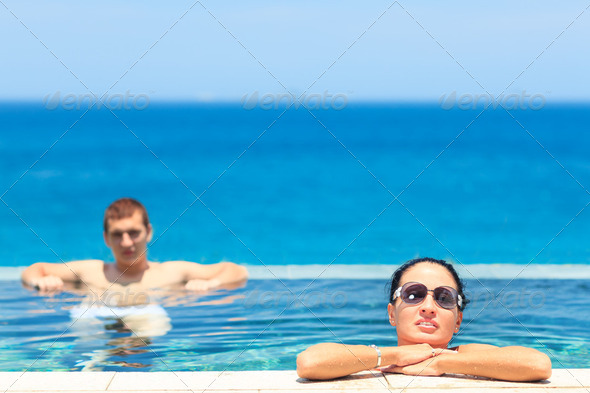 Couple in pool - Stock Photo - Images