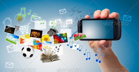 Hand and Multimedia phone - Stock Photo - Images