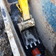Digger arm, sewage pipe digging - PhotoDune Item for Sale