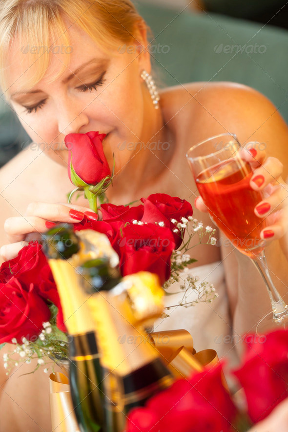 Attractive Blonde Woman Smells Roses at Mirror Near Champagne. - Stock Photo - Images