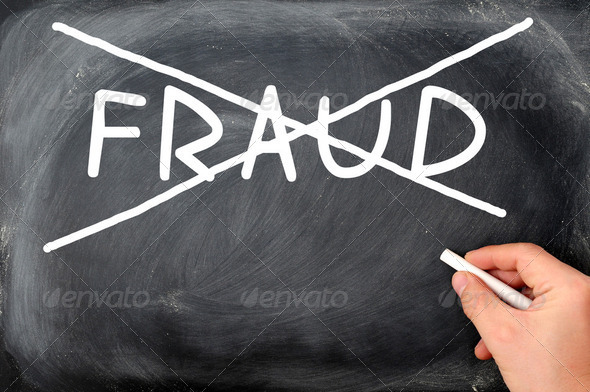 Crossing out fraud on a blackboard - Stock Photo - Images