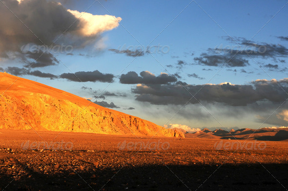Landscape of mountains and skies at sunset on the highlands of Tibet - Stock Photo - Images
