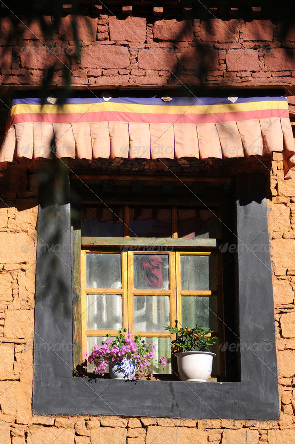 Closeup of a typical Tibetan window with beautiful decorations - Stock Photo - Images