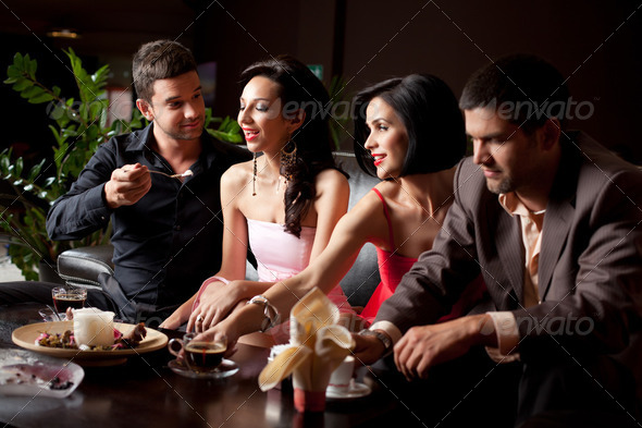 friends drinking coffee, eating ice-cream - Stock Photo - Images