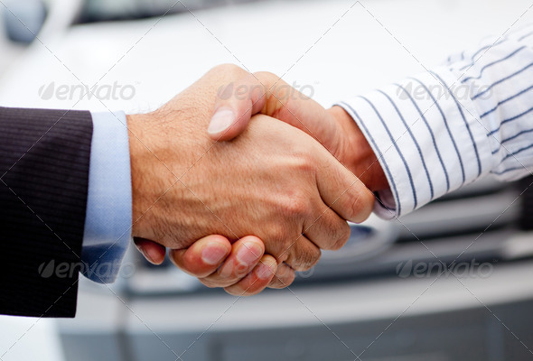 Closing deal on a car - Stock Photo - Images