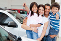 Family with keys of new car