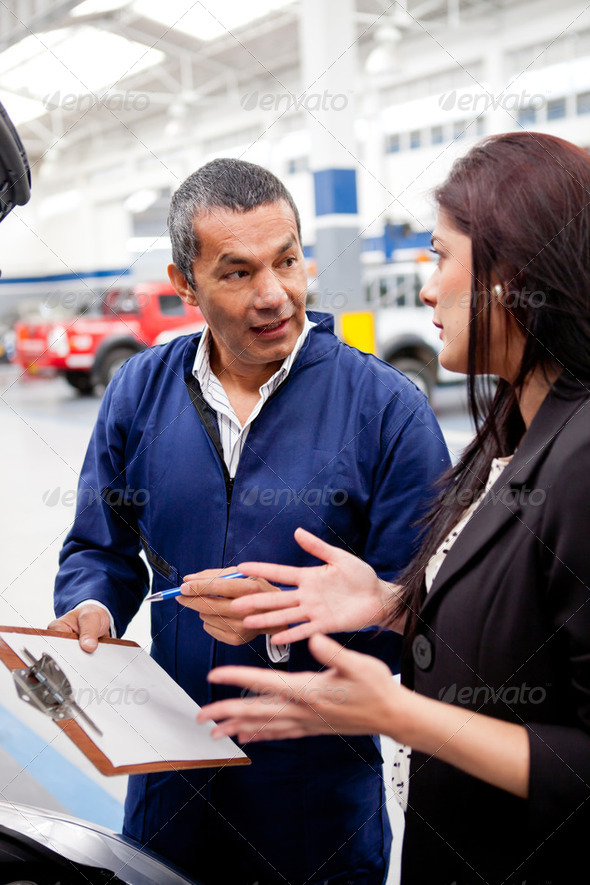 Woman at the car mechanic - Stock Photo - Images