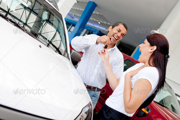 Man buying car to his wife - Stock Photo - Images