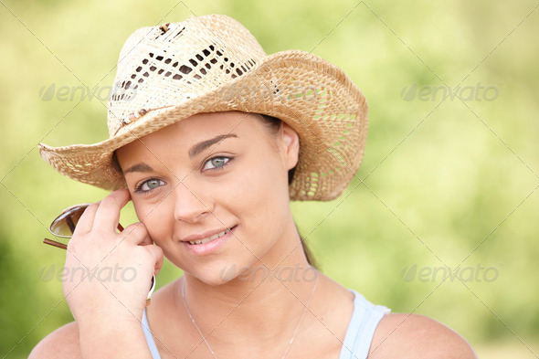 girl wearing summer hat - Stock Photo - Images
