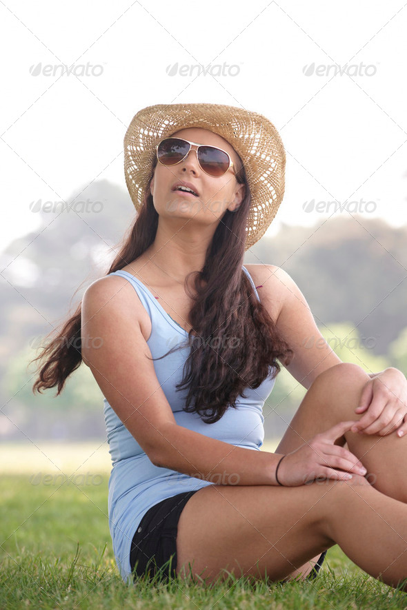 girl wearing hat and sunglasses - Stock Photo - Images