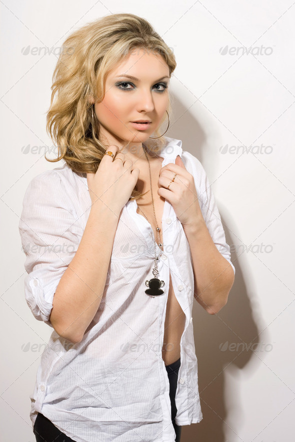 Sexy blond in white chemise. - Stock Photo - Images