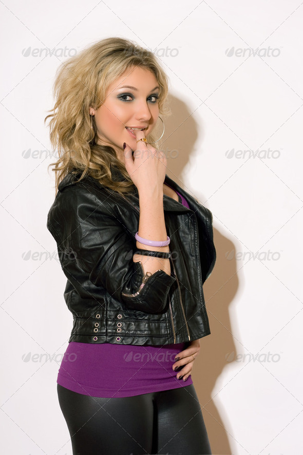 Frisky young blond girl - Stock Photo - Images